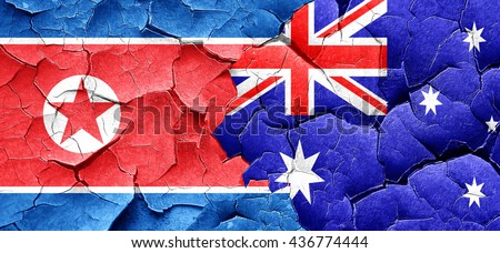 North Korea flag with Australia flag on a grunge cracked wall