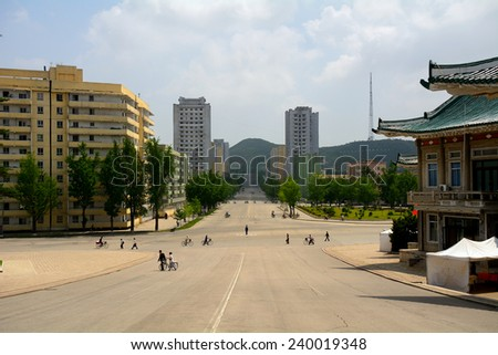 NORTH KOREA, KAESONG - JUNE 13: City center at June 13, 2014 in Kaesong, North Korea. The city is empty because of the lack of cars in the DPRK. - stock photo