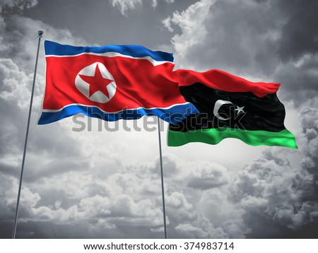 North Korea & Libya Flags are waving in the sky with dark clouds - stock photo