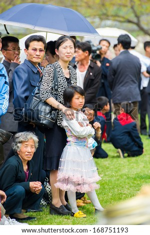 NORTH KOREA - MAY 1, 2012: Korean people participate in the public games due to the celebration of the International Worker's Day in N.Korea, May 1, 2012. May 1 is a national holiday in 80 countries