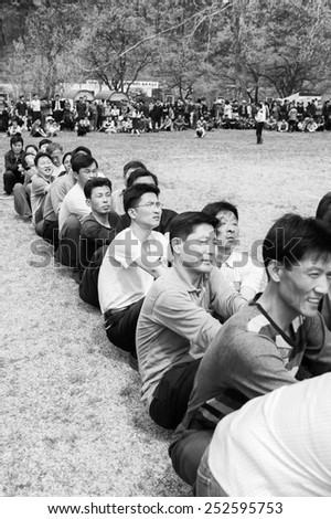 NORTH KOREA - MAY 1, 2012: Korean people participating in the tug of war game during the celebration of the International Worker's Day in N.Korea, May 1. May 1 is a national holiday in 80 countries