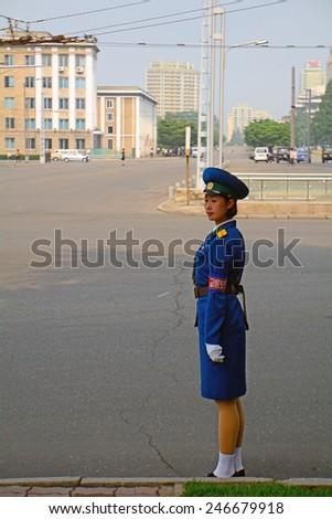 NORTH KOREA, PYONGYANG - JUNE 11: Police lady at June 11, 2014 in Pyongyang, North Korea. Traffic police employs mainly women in Pyongyang. - stock photo