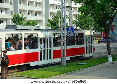 NORTH KOREA, PYONGYANG - JUNE 11: Tram at June 11, 2014 in Pyongyang, North Korea. Pyongyang receives new and modern trams from China - stock photo
