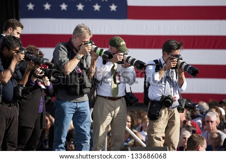 NORTH LAS VEGAS - NOVEMBER 01: Photographers at a Presidential Campaign rally on November 01, 2012  at Cheyenne Sports Complex in North Las Vegas, Nevada - stock photo