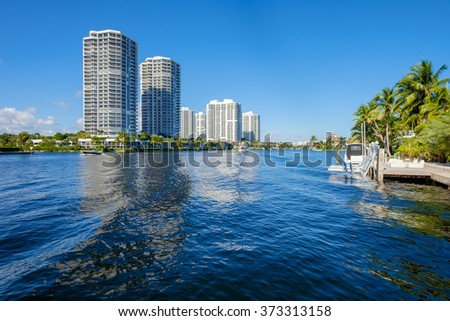 North Miami Intracoastal Waterway with condominiums and boats cruising by.