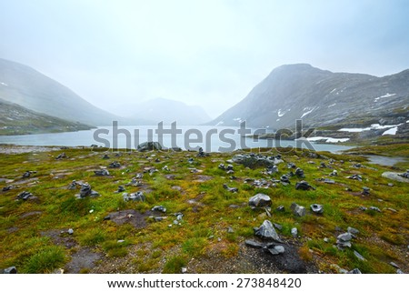 North Norway mountain spring tundra valley and small lake. - stock photo