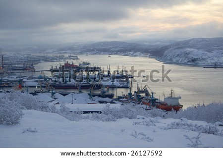 north of Russia: view of the Murmansk sea port from the hill in the winter - stock photo