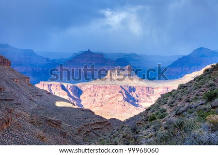 North Rim of Grand Canyon under storm clouds.