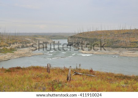 North river in late summer. Summer landscape of the Fish river on the Taimyr Peninsula in Russia.