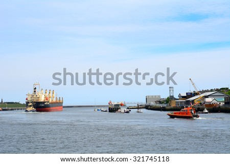 NORTH SHIELDS - 15 JUNE : Harbour at 15 June 2015 in North Shields, England. North Shields and South Shields are located in a bay's two sides, ideal places for marine transport.
