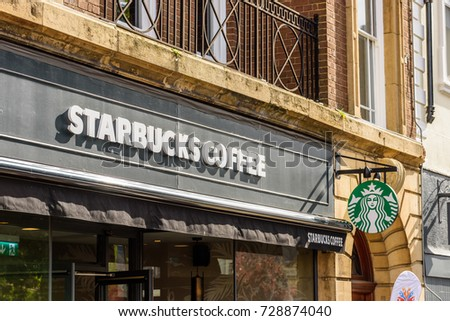 Northampton UK October 5, 2017: Starbucks Coffee logo sign in Northampton town centre.