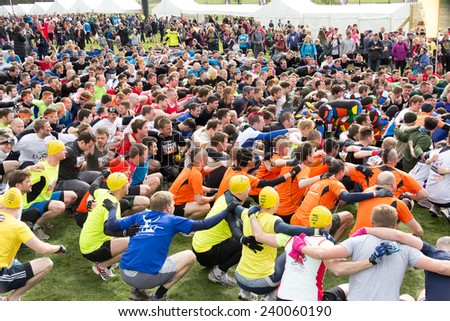 """NORTHAMPTONSHIRE/UK - May 4, 2013:  Participants  warm-up for the annual  Tough Mudder extreme sports competition raising money to support """"Help for Heroes. - stock photo"""