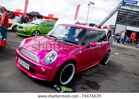 NORTHANTS, ENGLAND - AUG 2: Pink BMW Mini on display at the Annual Ultimate Street Car Show on August 2, 2008 in Northants, England, UK. Santa Pod is host to the show - stock photo