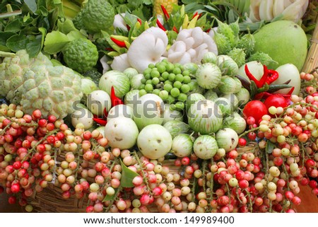 Northeastern Thai local vegetables and fruits in basket decoration - stock photo