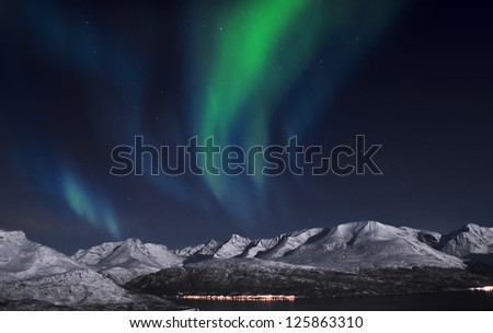 Northern light, captured above fjords in Norway - stock photo