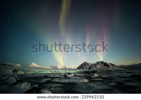 Northern Lights above the Arctic tidewater glacier - Spitsbergen - stock photo