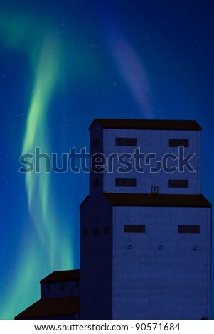 Northern Lights and Grain Elevator Saskatchewan Canada - stock photo
