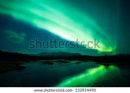 Northern lights (Aurora Borealis) in Iceland - stock photo