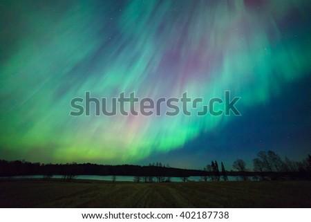 Northern lights aurora borealis landscape - stock photo