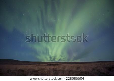 Northern Lights (Aurora Borealis) over Iceland - stock photo