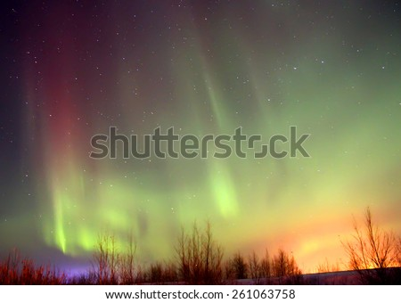 Northern lights in a night sky - stock photo