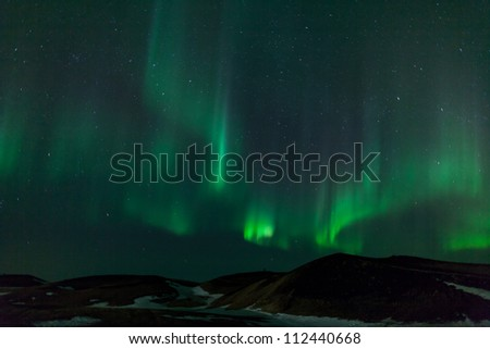 Northern lights over craters in Iceland - stock photo