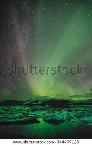 Northern lights over ice lagoon, Iceland - stock photo