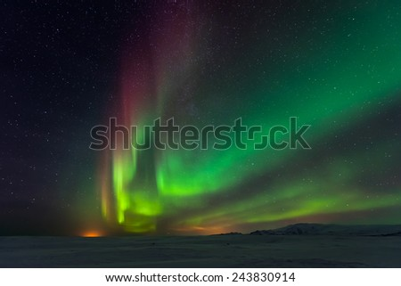 Northern Lights over mountains  - stock photo