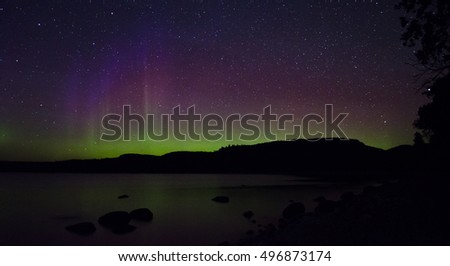 Northern lights provide green, purple and red colors.