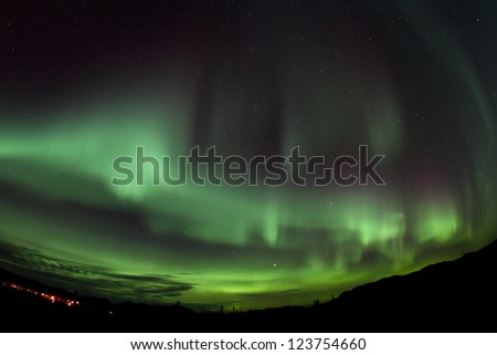 Northern Lights spread over the sky - stock photo