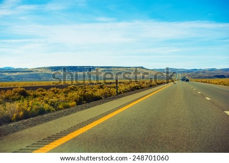 Northern Nevada Desert Highway. American Interstate Highway and the Rural Nevada Landscape. - stock photo