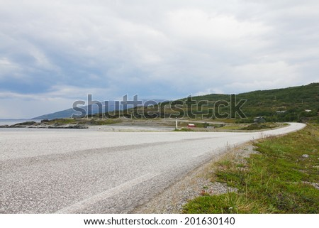 Northern Norwegian landscape with fjords, mountains and road - stock photo