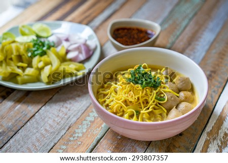 Northern Thai Noodle Curry Soup(Khao Sawy or Khao Soi).The manner of the people of north Thailand.