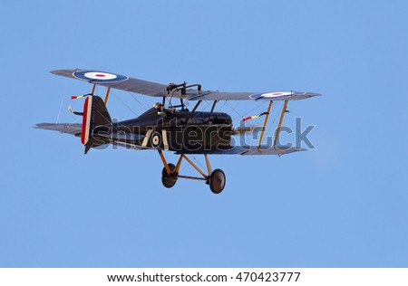 NORTHILL, UK - AUGUST 2: An Se5a scout fighter aeroplane from the WW1 era flies circuits around the airfield at Old Warden for the watching public to view on August 2, 2015 in Northill.