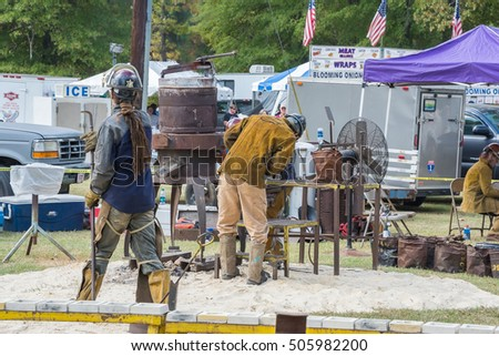 NORTHPORT, ALABAMA. USA - OCTOBER 15, 2016: The Kentuck Festival of the Arts 2016. Blacksmiths heating metal in a furnace for demonstration. It will be poured when it gets to the correct temperature.