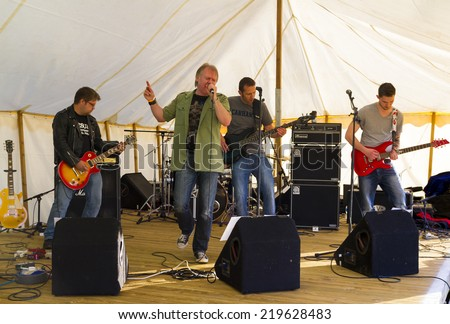 NORTHUMBERLAND, ENGLAND, AUGUST 30, 2014. Rock band, Dead Hands perform at fund raiser in aid of Great North Air Ambulance. August 30, 2014, Northumberland, England, UK.