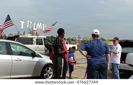 NORTHVILLE, MI/USA: AUGUST 30, 2016 ?? Discussions take place in a parking lot about the upcoming November election for President of the United States.  Donald Trump supporters debate the issues.