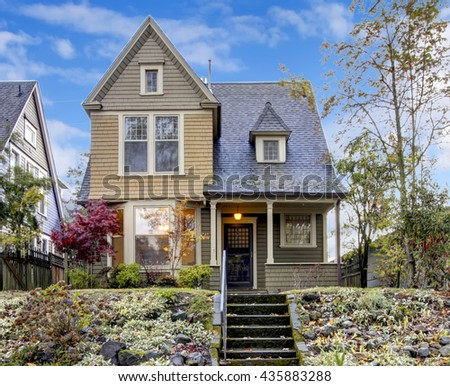 Northwest home with front porch and autumn landscape - stock photo