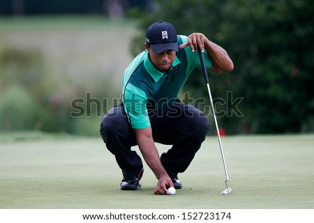 NORTON, MA-SEP 1: Tiger Woods lines up a putt on the green during the third round at the Deutsche Bank Championship at TPC Boston on September 1, 2013 in Norton, Massachusetts.  - stock photo