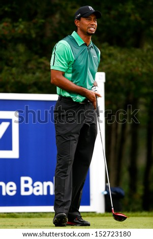 NORTON, MA-SEP 1: Tiger Woods watches his tee shot off the fourth hole during the third round at the Deutsche Bank Championship at TPC Boston on September 1, 2013 in Norton, Massachusetts.  - stock photo