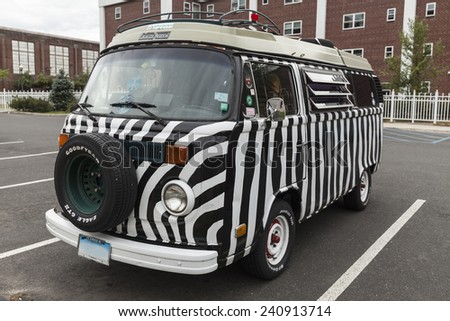 Norwalk, CT - August 15, 2014: Iconic Volkswagen minivan painted as zebra with hippies stickers - stock photo