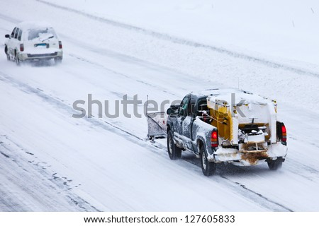 NORWALK,CT - FEBRUARY 09:  Car on I-95 after winter storm in Norwalk on February 09,2013