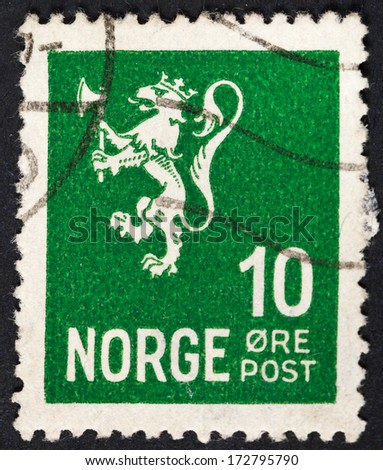 NORWAY - CIRCA 1923: A postage stamp printed in the Norway shows symbol of norwegian monarchy lion on green background, circa 1923