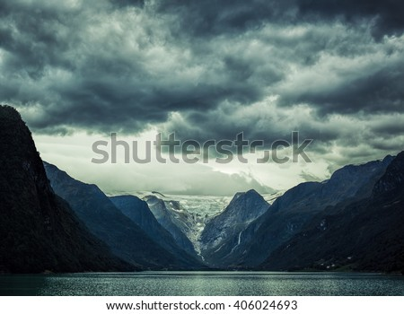 Norway fjord severe landscape. Dramatic dark colors.