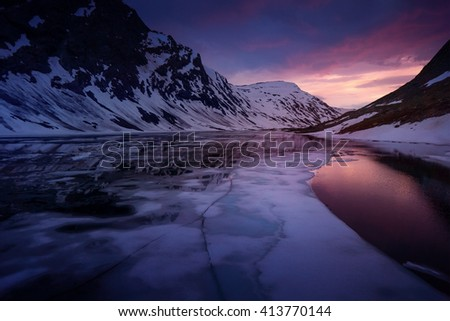 Norway Glacier lake after sunset - drone photo, ice in foreground - stock photo