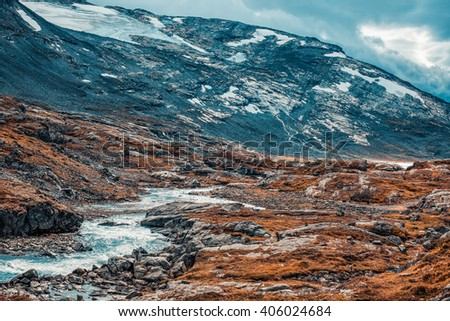 Norway high mountains landscape with small river. Autumn film style colors. - stock photo