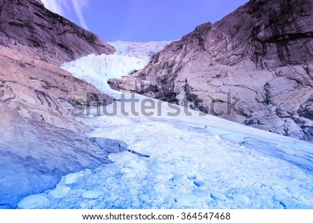 Norway, Jostedalsbreen National Park. Briksdalsbreen glacier in Briksdalen valley. Filtered color style. - stock photo