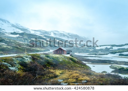 Norway landscape, a small village in inclement weather snowstorm and fog in the mountains. Beautiful Nature Norway. - stock photo