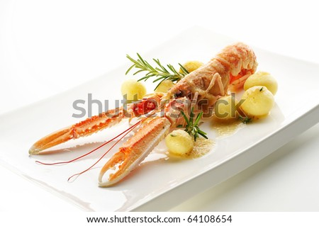 Norway lobster with young potato - stock photo
