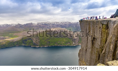 NORWAY - MAY 23, 2015: Tourists enjoy the breathtaking view from the Preikestolen (Pulpit) rock, Lysefjord, Norway.